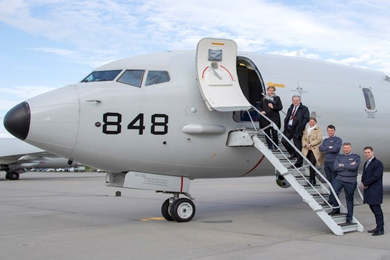 Defence delegates boarding a P8-A Poseidon at RAF Lossiemouth.