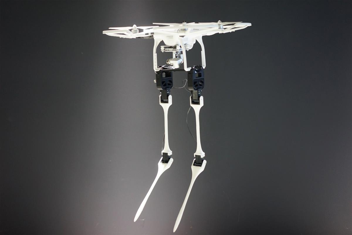Aerial biped by the Japanese artists Azumi Maekawa and Shunji Yamanaka.  A white drone with long, feet with many separate joints. Used with permission from Ars Electronica.