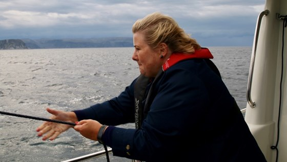 Prime Minister Erna Solberg fishing outside Mehamn.