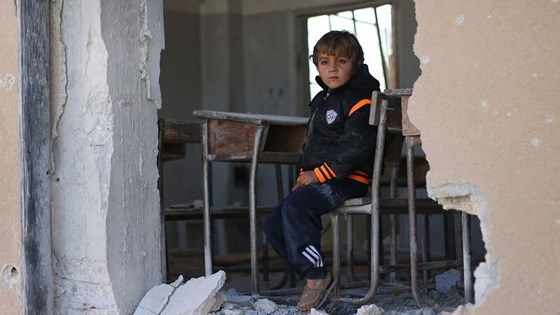 "Ahmad, 6, sits in his damaged classroom at the education compound that was attacked in Has, rural Idleb, on 26 October 2016. ""I wanted to become a doctor, but I don't think this is possible anymore because the school was hit. I became afraid of coming here. My dad is saying he will move us to another school in a new village,"" Ahmad says. ©UNICEF/2016/Syria/Idleb/Khalil Ashawi"